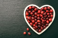 Cranberries on white tray on black background. Royalty Free Stock Photo
