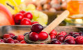 Cranberries in wooden bowl macro shot Stock Photos