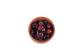 Cranberries in the wooden bowl on white background Stock Photos
