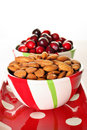 Cranberry & almonds in a bowl on polka dots Royalty Free Stock Images