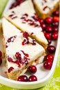 Cranberry bliss bar made with chunks of white chocolate and dried cranberries topped with sweet cream cheese icing Royalty Free Stock Photography