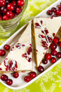 Cranberry bliss bar made with chunks of white chocolate and dried cranberries topped with sweet cream cheese icing Royalty Free Stock Image