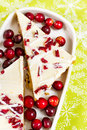 Cranberry bliss bar made with chunks of white chocolate and dried cranberries topped with sweet cream cheese icing Royalty Free Stock Images