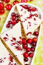 Cranberry bliss bar made with chunks of white chocolate and dried cranberries topped with sweet cream cheese icing Stock Photo