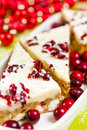 Cranberry bliss bar made with chunks of white chocolate and dried cranberries topped with sweet cream cheese icing Stock Photos