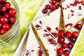 Cranberry bliss bar made with chunks of white chocolate and dried cranberries topped with sweet cream cheese icing Royalty Free Stock Photo