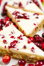 Cranberry bliss bar made with chunks of white chocolate and dried cranberries topped with sweet cream cheese icing Stock Image