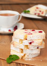 Cranberry cake partly slices semolina and cup of tea on wooden table vertical Royalty Free Stock Photos