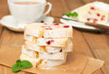 Cranberry cake partly slices semolina on wooden table horizontal Royalty Free Stock Photography