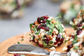 Cranberry cheese ball nut made with cream goat or feta parsley cranberries and chopped pecans over a rustic Stock Photos