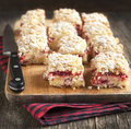 Cranberry cream cheese coffee cake on wooden board Stock Photos