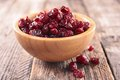 Cranberry dry on wood background Stock Photo