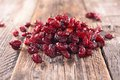 Cranberry dry on wood background Royalty Free Stock Image