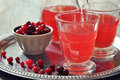 Cranberry juice in glass with fresh berry on wooden background Stock Photography