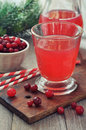 Cranberry juice in glass with fresh berry on wooden background Stock Images