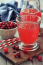 Cranberry juice in glass with fresh berry on wooden background Royalty Free Stock Photography