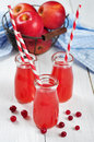 Cranberry juice in glass jars Royalty Free Stock Images