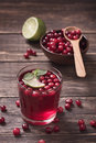Cranberry juice with mint vertical Royalty Free Stock Images