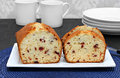 Cranberry pound cake sliced on a plate homemade freshly baked whole portion and pieces Royalty Free Stock Photography