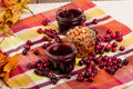 Cranberry sauce with cranberries and fall leaves jars of on a table Royalty Free Stock Photo