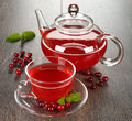 Cranberry tea in a glass cup on a brown table Royalty Free Stock Image
