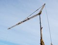 Crane against the blue sky Royalty Free Stock Photo
