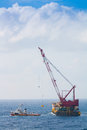 Crane barge doing marine heavy lift installation Royalty Free Stock Photography