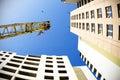 Crane on blue sky with bird Royalty Free Stock Photo