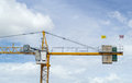 Crane in blue sky in construction site Royalty Free Stock Image