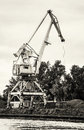 Crane in cargo port, black and white photo Royalty Free Stock Photo