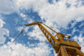 Crane and clouds low angle shot of for ship repairs Stock Photos