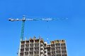 Crane and construction site building against blue sky Royalty Free Stock Photo