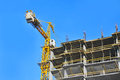 Crane and construction site building against blue sky Royalty Free Stock Image