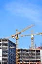 Crane and construction site building against blue sky Royalty Free Stock Photos