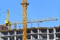 Crane and construction site building against blue sky Royalty Free Stock Photography