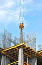 Crane and construction site building against blue sky Stock Photography