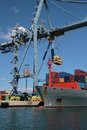 Crane container ship working port alicante spain Royalty Free Stock Photo