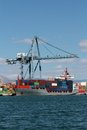 Crane container ship working port alicante spain Stock Photo