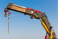 Crane with detail of a jib against blue sky Stock Photography