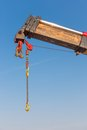 Crane with detail of a jib against blue sky Stock Photos
