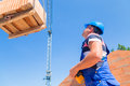 Crane driver deliver a pallet bricks on construction or building Royalty Free Stock Photo