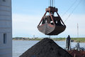 Crane grab with coal russia Stock Photography