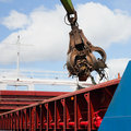 Crane grabber  Loading ship with steel Stock Photos