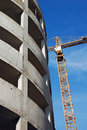 Crane and highrise garage construction site Royalty Free Stock Photos