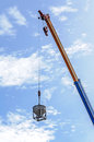 Crane hoist concrete bucket at construction site Royalty Free Stock Photo
