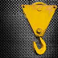 Crane hook on diamond plate Royalty Free Stock Images