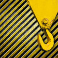 Crane hook on metal stripe background Royalty Free Stock Image
