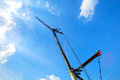 Crane a industrial against a blue sky Royalty Free Stock Photo