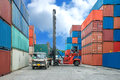 Crane lifter loading container box into truck in import export l logistic zone Stock Photography
