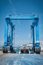 Crane lifting boats at harbor Stock Photography